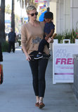 Charlize Theron carried baby Jackson.