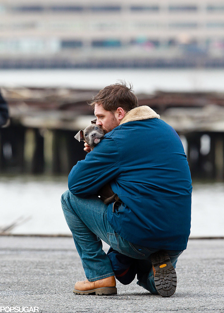 Tom Hardy and his four-legged costar shared a moment on the set of his film Animal Rescue in March.