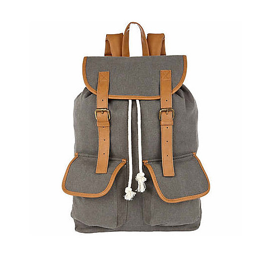 You could take this versatile River Island backpack ($56), made from gray canvas and brown straps, either on a hike or to the office.