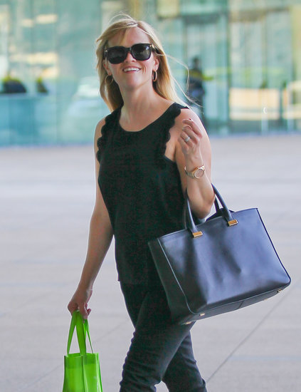 Reese Witherspoon held on to her black bag from The Row.