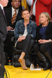 Charlize Theron brought her mom along for a Lakers game in January. We love how she paired black waxed jeans with a white tee, denim jacket, and nude ankle booties.