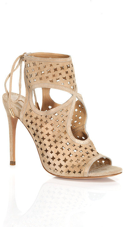 Embrace the trend with these Aquazzura Sexy Star booties ($485). The cutout finish is a little edgier, but the neutral hue means they'll go with everything. They'll only add to the sexy vibe of a cocktail dress, but they're also a perfect counter to worn boyfriend jeans and a button-down.