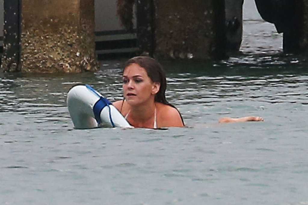 Bikini-Clad Isla Fisher Makes a Splash on Set
