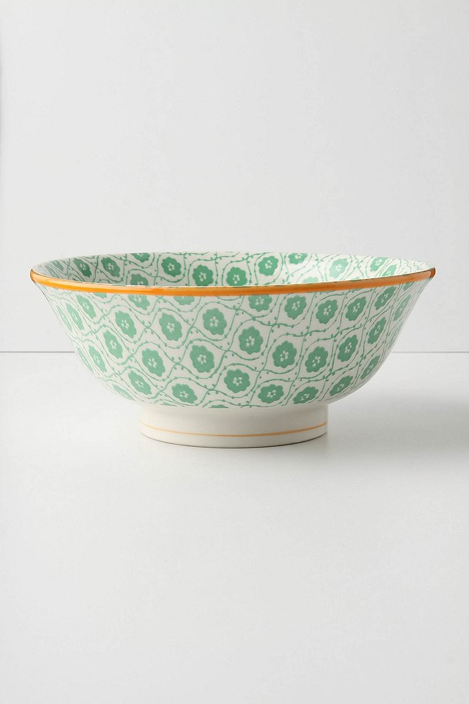 A dainty green serving bowl ($24) with gold accents combines two of holiday's major colors and is perfect for springtime.