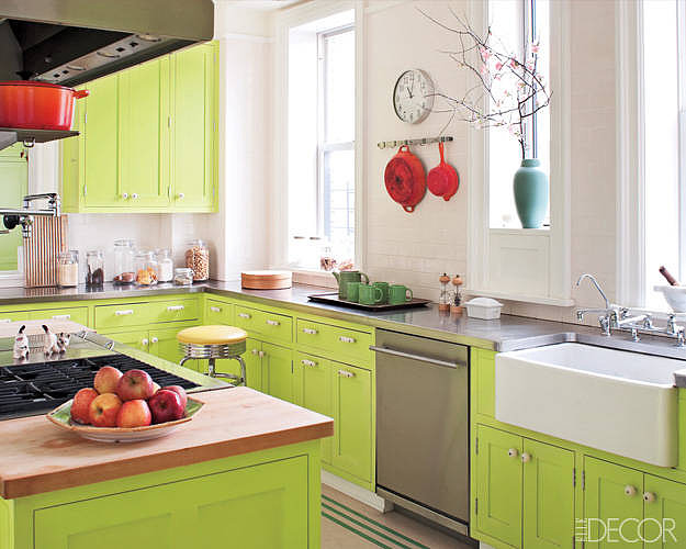 Lime-green cabinets offset by stainless-steel counter tops make for a truly unique cooking space.  Source: Elle Decor