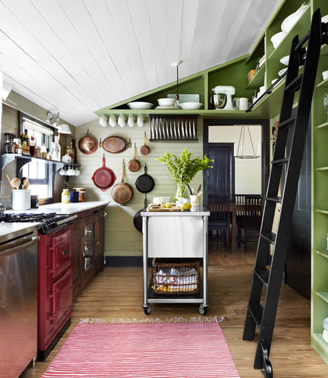 Green shelving was used to add depth and character to this rather small kitchen.  Source: Alec Hemer for Country Living
