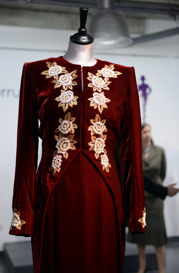 A detail of the Catherine Walker dress worn to the premiere of Steel Magnolias in 1990 and during a state visit to Korea in 1992.