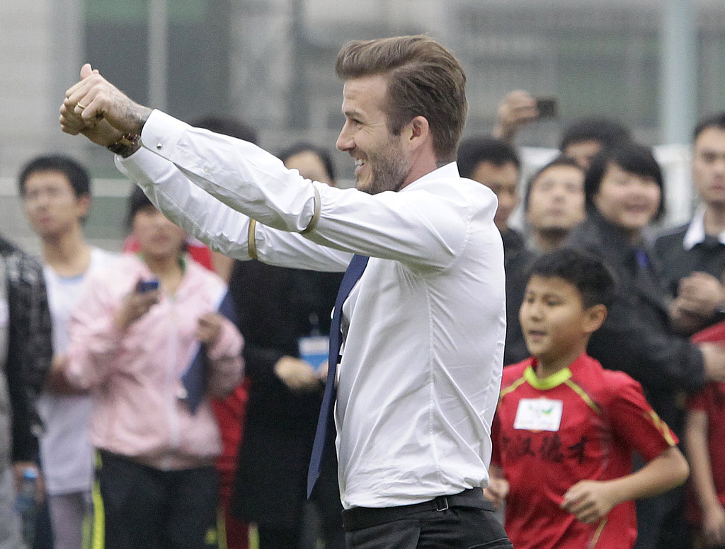 David Beckham Shows His Abs in China While Victoria Stays Busy in London