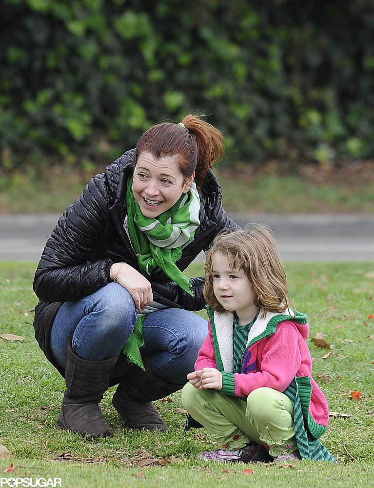 Alyson Hannigan and her daughter Satyana layered on shades of green to watch the LA marathon on St. Patrick's Day 2013.