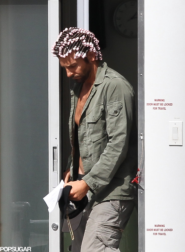 Bradley Cooper wore curlers in his hair on set in Boston.