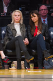 At the Lakers game in March, Julianne Hough cheered on the team with Nina Dobrev, who sported a bright red top with a black leather jacket, gray ankle booties, and a black Tory Burch satchel.