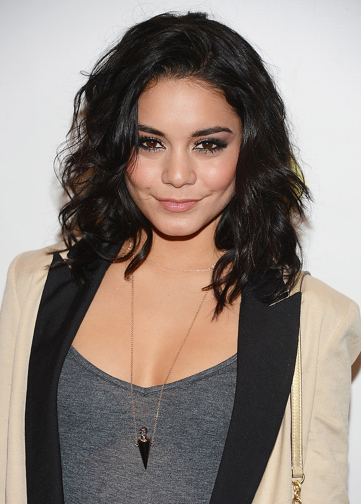 Take a styling cue from Vanessa Hudgens, and play up your natural texture. You can enhance your waves with a quick hit of a curling iron and don't worry about a part — just let your hair fall where it wants.
