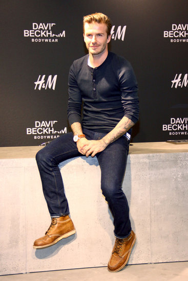 David Beckham wore jeans and a blue shirt.
