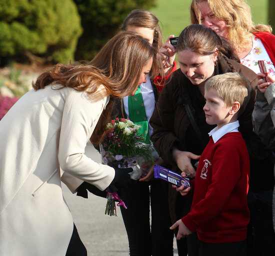 Kate Middleton greeted a small boy during her official visit.
