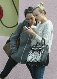 Diane Kruger took a look at her phone with a friend.