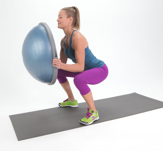 Place the ball side of the BOSU on the ground, then jump or walk ...