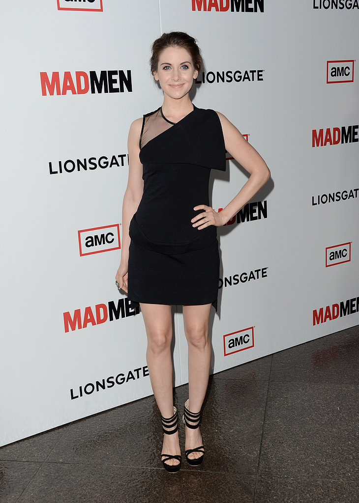 Alison Brie stepped out in a sexier look — a black, asymmetrical, and sheer inset LBD and black strappy platforms.