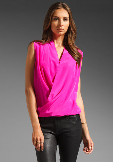 Amanda Uprichard's blouse ($180) balances an electric hue with a chic silhouette. Add it to your staple denim and heels for a night out, or pair it with a pencil skirt and blazer for the office.