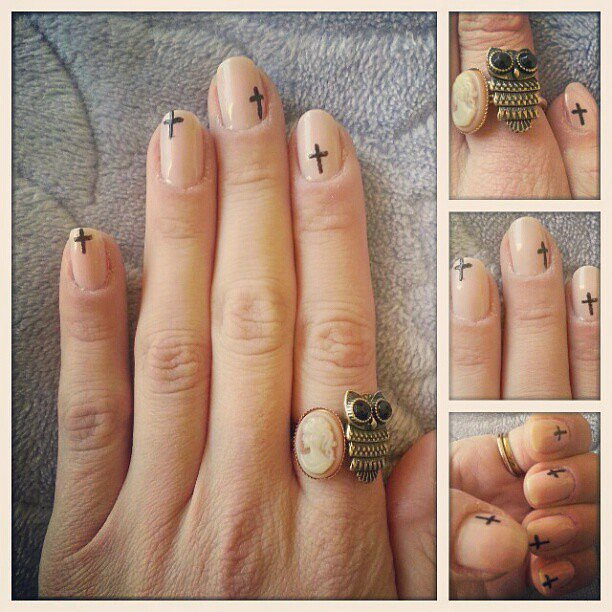 Tiny black crosses added some edge to this otherwise neutral manicure. Source: Instagram user lydialvp