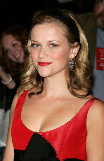 For the 2005 Walk the Line premiere in New York, Reese was back to her blond roots. She wore a red and black frock, which she coordinated with vibrant cherry lips and a black headband.