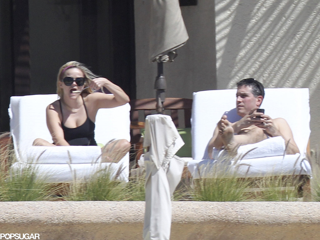 Reese Celebrates Her Birthday Poolside in a Suit With Shirtless Jim