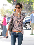 Alessandra Ambrosio took a phone call during her outing.
