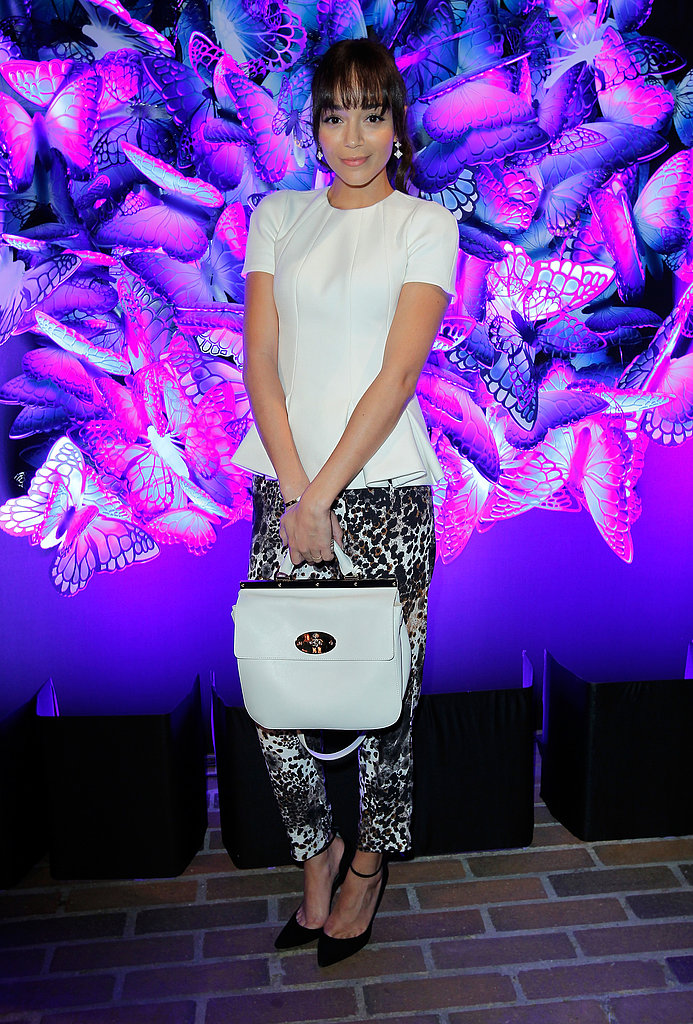 Ashley Madekwe proved you don't need a cocktail dress to make an event-worthy impression. The actress outfitted a pair of Mulberry animal-print trousers with a peplum-trimmed Mulberry blouse for a dinner celebrating the label's Fall '13 collection.