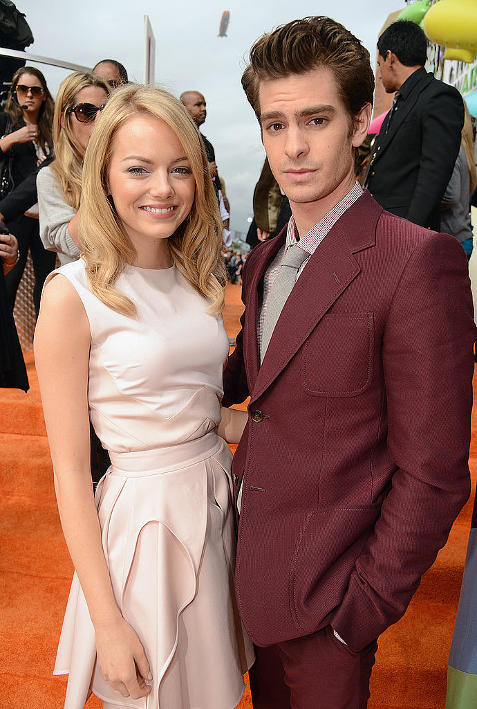 Onscreen and real-life couple Emma Stone and Andrew Garfield posed on the orange carpet in 2012.