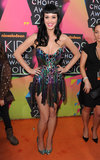 Katy Perry never disappoints on the orange carpet, and in 2010, she chose a holographic strapless mini to turn heads.