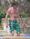 Patrick Dempsey went shirtless poolside in Cabo on Saturday during a family Spring break getaway.