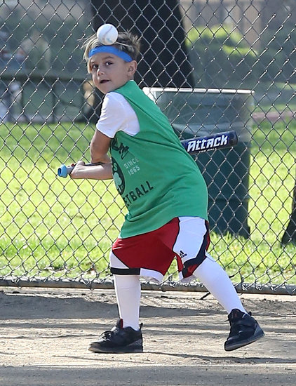 Kingston Rossdale swung his bat at a baseball.