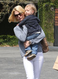 January Jones carried her son, Xander, in LA on Monday.
