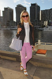 In this look, pink jeans and a pastel purple Prada purse blended harmoniously, while a black sheer-sleeved blazer added edge.