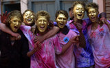 A group of guys painted their faces gold for Holi festival celebrations in Kathmandu, Nepal.