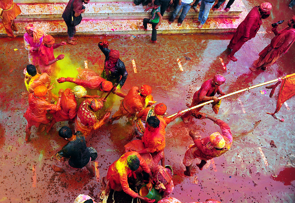 Hindu devotees participated in the Lathmar Holi festival at the Nandji Temple in Nandgaon, India.