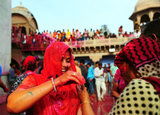 A woman participated in rituals for the Lathmar Holi festival at the Nandji Temple in Nandgaon, India.