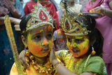 Children dressed as Lord Krishna and Radha during a Holi celebration at a temple in Amritsar, India. The Holi tradition of playing with colors has flirtatious origins. According to legend, Hindu god Krishna was jealous of his love Radha's fair skin, since his was dark. After his mother Yashoda joked that he could change Radha's face to whatever color he wanted, Krishna applied color to Radha's face, inspiring the tradition that continues to this day.