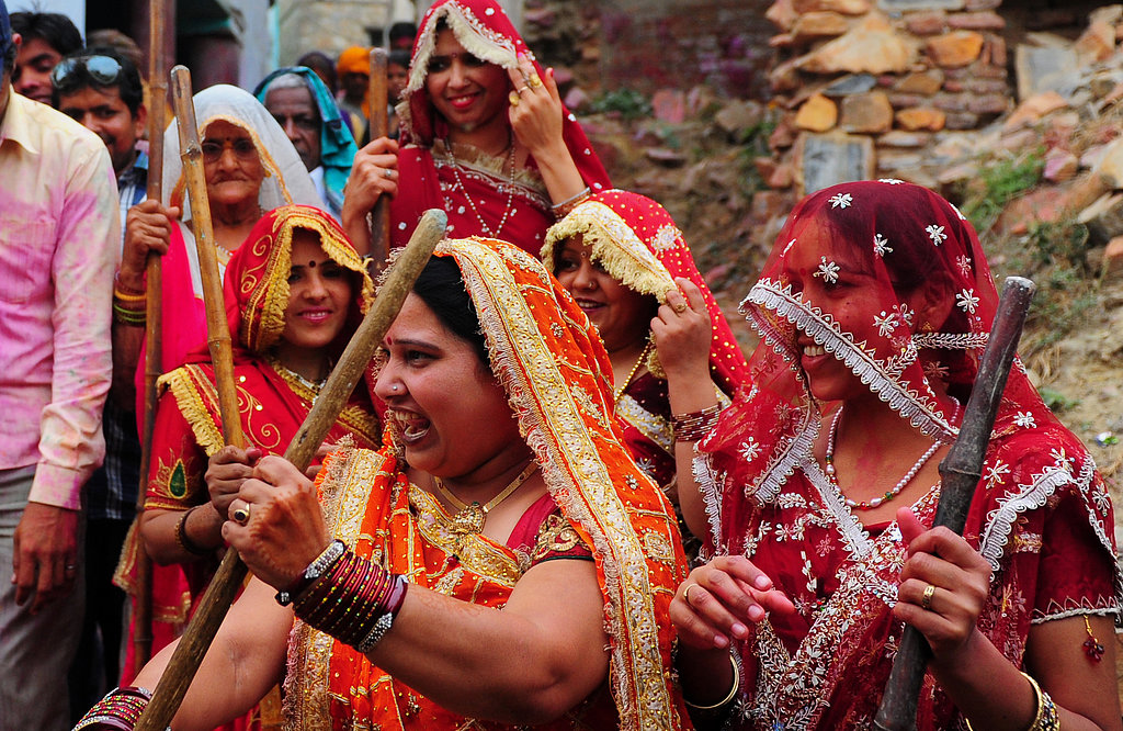 In keeping with tradition, a group of women wielded sticks, called lathis, during Lathmar Holi celebrations in the village of Nandgaon near Mathura, India.