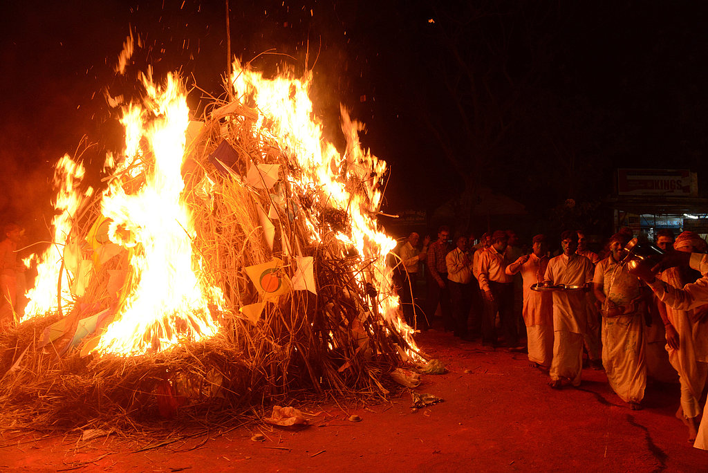 Hindu devotees watched the Holika bonfire in Ahmedabad, India.