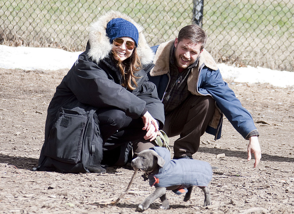 Tom Hardy and Noomi Rapace played with their cute costar on the set of Animal Rescue in NYC on Tuesday.