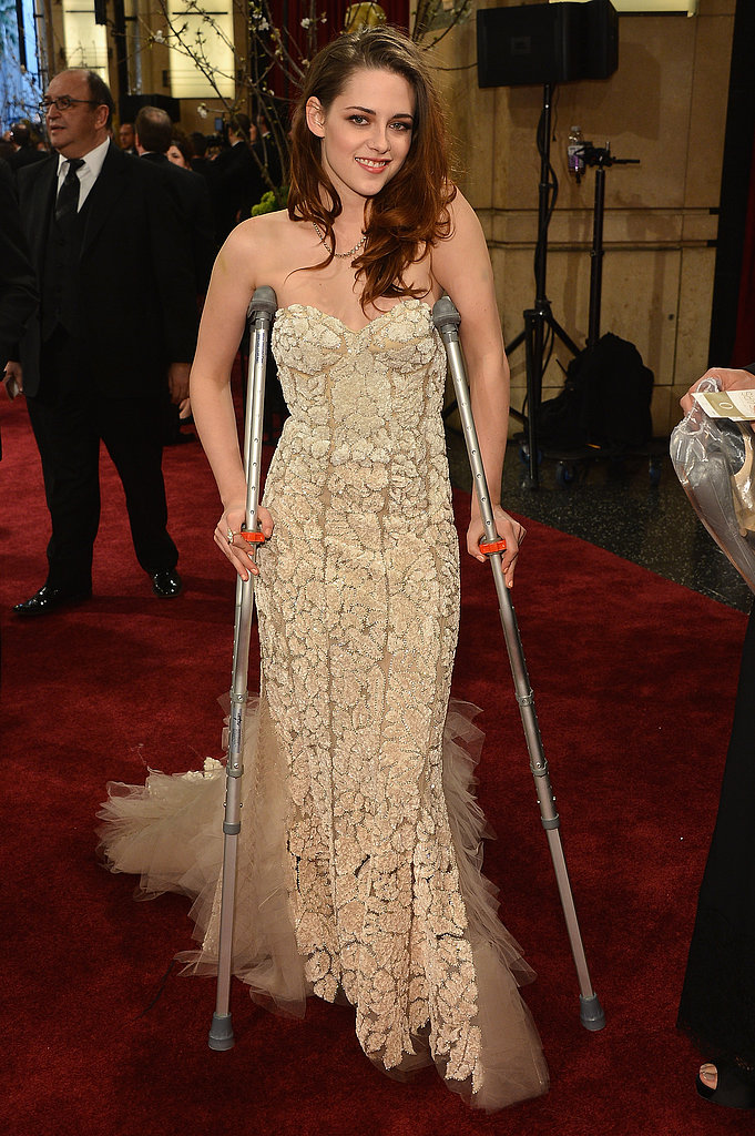 Kristen Stewart paired her Oscars gown with crutches on the red carpet in LA in February 2013.