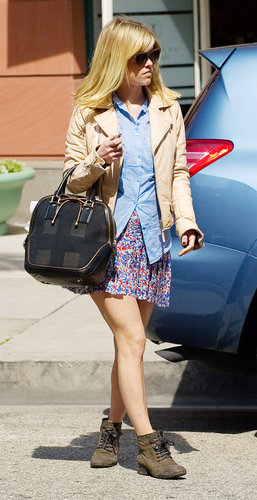 Alice Eve created a sweet-cum-edgy Spring ensemble by pairing a chambray blouse with a printed miniskirt, then finishing with a nude leather biker jacket, a Burberry bag, and lace-up booties.