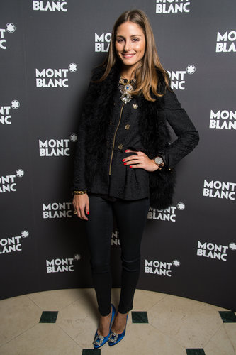 Olivia went casual with a glamorous twist, adding a jeweled statement necklace and a pair of embellished blue Manolo Blahnik heels to her all-black look at a Montblanc dinner in Switzerland in January.