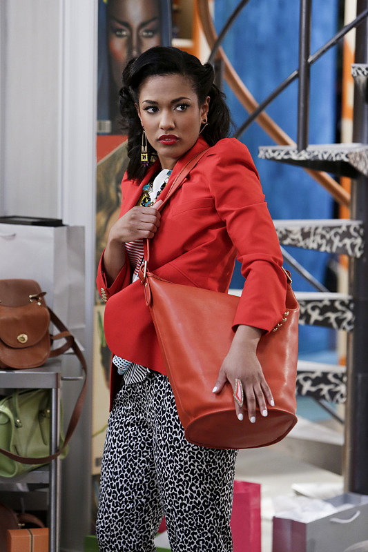 Larissa accessorized her fitted red blazer with an orange leather Coach duffel. Score a similar Coach bag ($398) to work with your favorite Spring jackets. Source: The CW