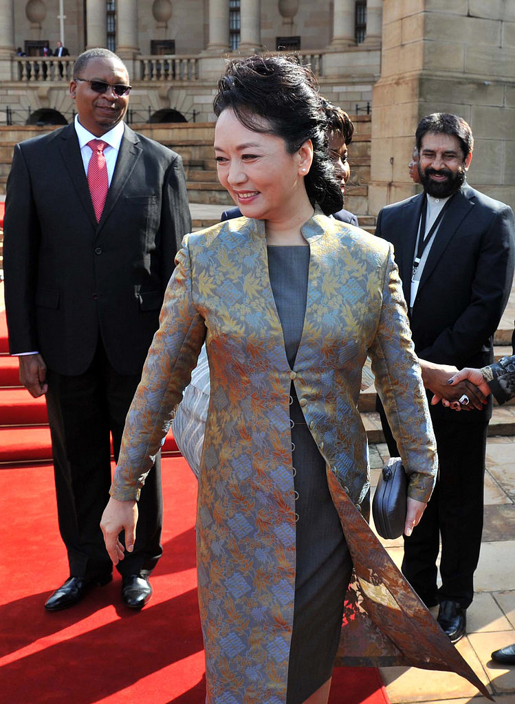 Peng Liyuan's fashion choices have been watched closely during her first international trip as first lady.
