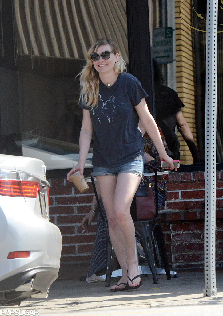 Kirsten Dunst smiled as she carried her iced coffee to the car.