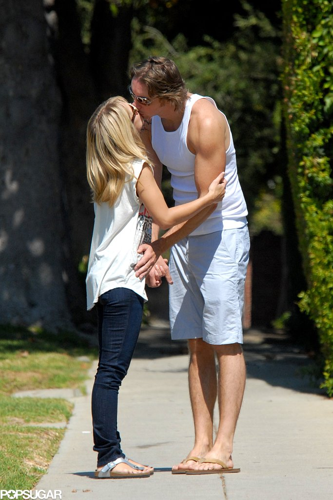 Dax leaned down to kiss Kristen during a day out in LA in September 2008.