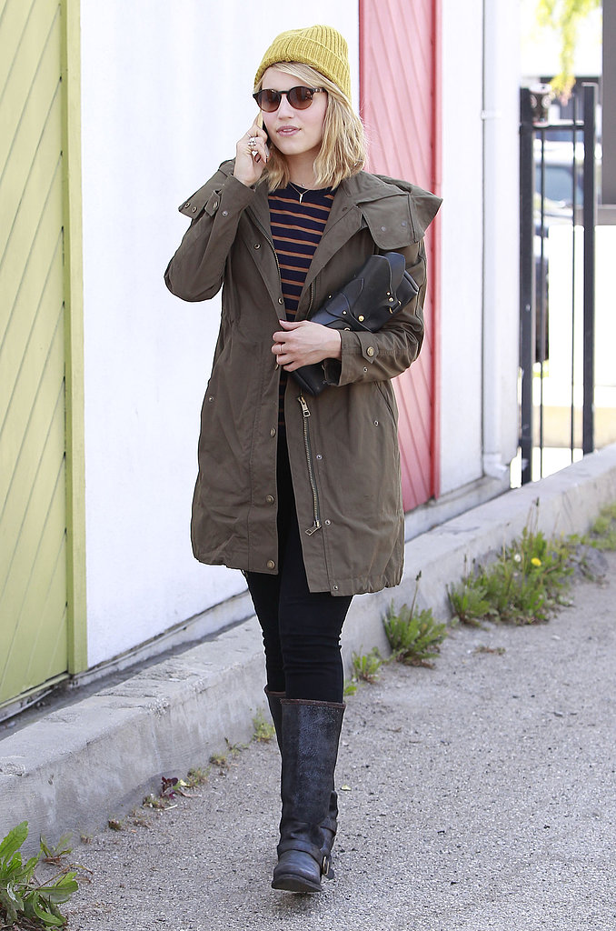 Dianne Agron spent a day out in LA wearing an olive-green anorak over a striped top and black jeans. A yellow knit beanie, round retro sunglasses, and black biker boots completed her look.