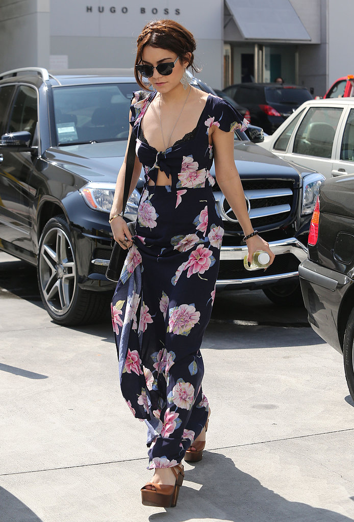 Vanessa Hudgens channeled '90s-inspired cool in an American Gold floral print, cutout maxidress and platform sandals while running errands in Beverly Hills.