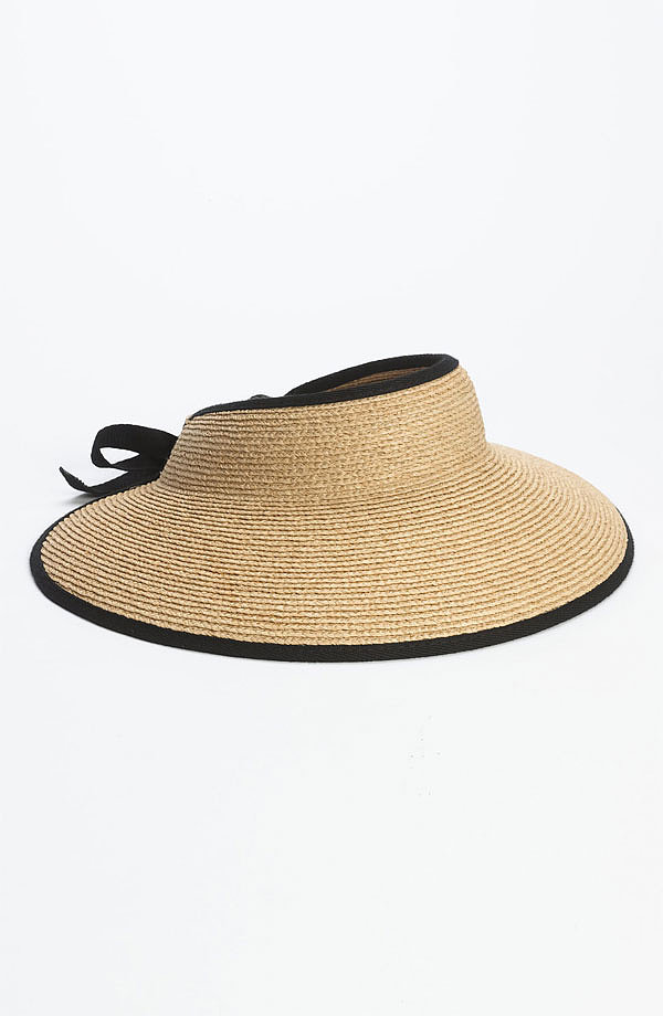 We picture wearing this Helen Kaminski raffia visor ($115) with a little black bikini and cat-eye shades while sitting poolside with a new novel.